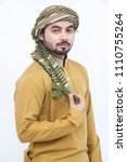 Small photo of Man standing and posing in wearing kameez shalwar. Eid look. isolated on white background Eid mubarak offer. front veiw