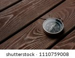 traditional compass on a wooden ... | Shutterstock . vector #1110759008