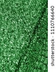 Small photo of Texture, pattern. The cloth is silk green. It has shiny luster and characteristic small holes that run horizontally across the entire fabric. Be creative with beautiful home decor accents