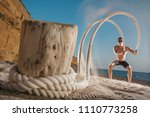 man training with battle rope... | Shutterstock . vector #1110773258