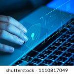 woman scrolling on a laptop | Shutterstock . vector #1110817049