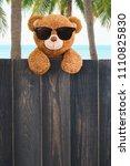 cute teddy bear  wears... | Shutterstock . vector #1110825830