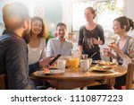 a group of multi ethnic friends ... | Shutterstock . vector #1110877223