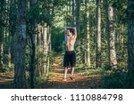 fit young man exercising in the ... | Shutterstock . vector #1110884798