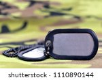 military dog tags on camouflage ... | Shutterstock . vector #1110890144