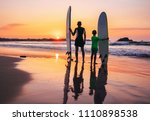 father and son surfers stay on... | Shutterstock . vector #1110898538