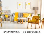 yellow wooden armchair in... | Shutterstock . vector #1110910016