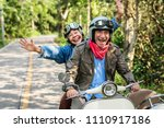 senior couple riding a classic... | Shutterstock . vector #1110917186
