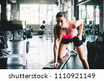 woman workout by lifting... | Shutterstock . vector #1110921149
