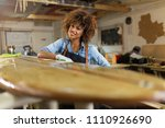 happy young woman working on... | Shutterstock . vector #1110926690