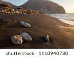 perissa beach during sunrise on ... | Shutterstock . vector #1110940730