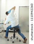 male dentist stretching his... | Shutterstock . vector #1110942260