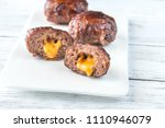 bacon meatballs stuffed with... | Shutterstock . vector #1110946079