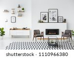 grey armchairs between black... | Shutterstock . vector #1110966380