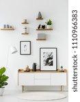 poster on wooden cupboard in... | Shutterstock . vector #1110966383