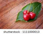 cherry   heap of fresh berries... | Shutterstock . vector #1111000013