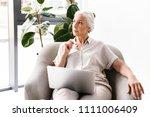 pensive mature business woman... | Shutterstock . vector #1111006409