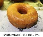 closeup baked plain doughnut or ...   Shutterstock . vector #1111012493