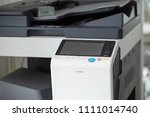 Small photo of Close up of Copier machine office appliance. Selective focus.