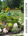 bright flowerbed with various... | Shutterstock . vector #1111014758