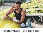 happy sportsman with bottle of... | Shutterstock . vector #1111015100