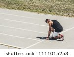 side view of male sprinter in... | Shutterstock . vector #1111015253