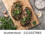 mushrooms garlic toasts on...   Shutterstock . vector #1111027883