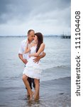 Portrait of married couple in at the sea scenery - stock photo