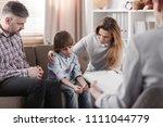 mother hugging her autistic son ... | Shutterstock . vector #1111044779