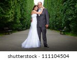 Portrait of married couple in green park scenery - stock photo