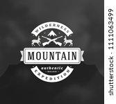 mountains camping logo emblem... | Shutterstock .eps vector #1111063499