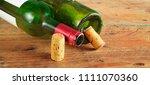 wine bottles and wine corks ... | Shutterstock . vector #1111070360