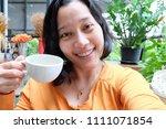 selfie asian woman  drinking...   Shutterstock . vector #1111071854