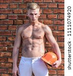 builder with muscular torso and ... | Shutterstock . vector #1111074920