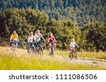 family riding their bicycles on ... | Shutterstock . vector #1111086506