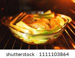glass baking form in oven... | Shutterstock . vector #1111103864