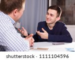 guy with his father are resting ... | Shutterstock . vector #1111104596