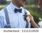 bride attaches weddind bouquet... | Shutterstock . vector #1111113020