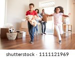 excited family carrying boxes... | Shutterstock . vector #1111121969