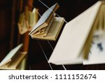 books hung to decorate an... | Shutterstock . vector #1111152674