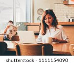 asain woman working with laptop ...   Shutterstock . vector #1111154090