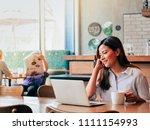 asain woman working with laptop ...   Shutterstock . vector #1111154993