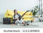female teen musician playing... | Shutterstock . vector #1111185803