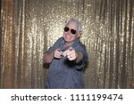 man posing in a photo booth. a...   Shutterstock . vector #1111199474