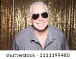 man posing in a photo booth. a...   Shutterstock . vector #1111199480