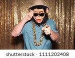 man in a rubber monkey mask...   Shutterstock . vector #1111202408