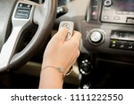 lady's hand pressing on car's... | Shutterstock . vector #1111222550