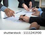 business team partners reading... | Shutterstock . vector #1111241930
