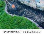 gardener using a torch to burn... | Shutterstock . vector #1111263110