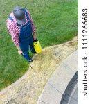 man spraying weed killer on... | Shutterstock . vector #1111266683